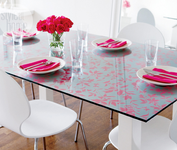Glass-dining-room-table-with-wallpaper-top