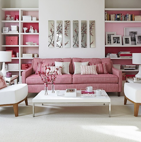white-and-pink-contemporary-living-room-with-pink-sofa-and-painted-shelf-backs